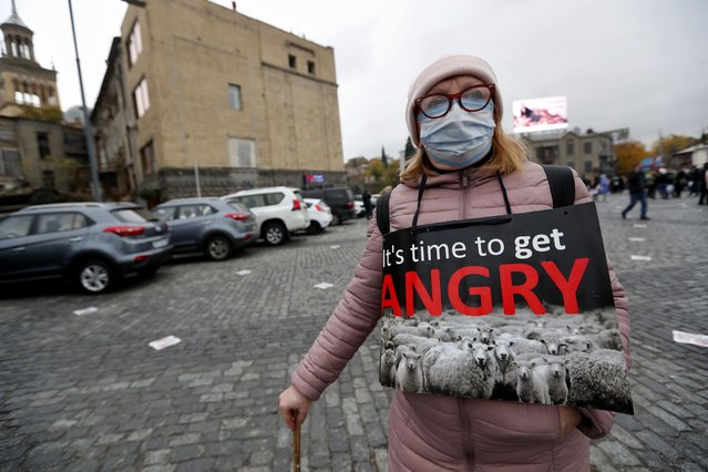 A woman attends an opposition rally in Tbilisi, Georgia, 18 November 2020, on the day of US Secretary of State Mike Pompeo's visit to Tbilisi. Members of Georgian opposition protest against the results of the election and demand new parliamentary election in Georgia. (Photo by Zurab Kurtsikidze/EPA/EFE)