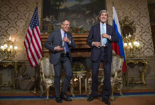 US Secretary of State John Kerry, right and Russian Foreign Minister Sergei Lavrov laugh, during their meeting, at Villa Taverna, on Sunday, December 14, 2014, in Rome. Kerry and Lavrov discussed the ongoing Middle East peace process, and rising tensions in Ukraine. (Photo by Evan Vucci/AP Photo)
