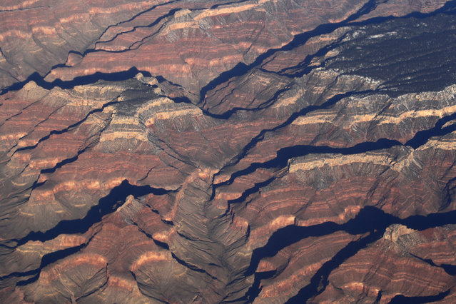 This December 17, 2019 file aerial photo shows Arizona's Grand Canyon. A leading conservation agency is warning that climate change is damaging the U.N.' most cherished heritage sites. Climate change is increasingly damaging the U.N.'s most cherished heritage sites, a leading conservation agency warned Wednesday Dec. 2, 2020, reporting that Australia's Great Barrier Reef and dozens of other natural wonders are facing severe threats. (Photo by Charlie Riedel/AP Photo/File)