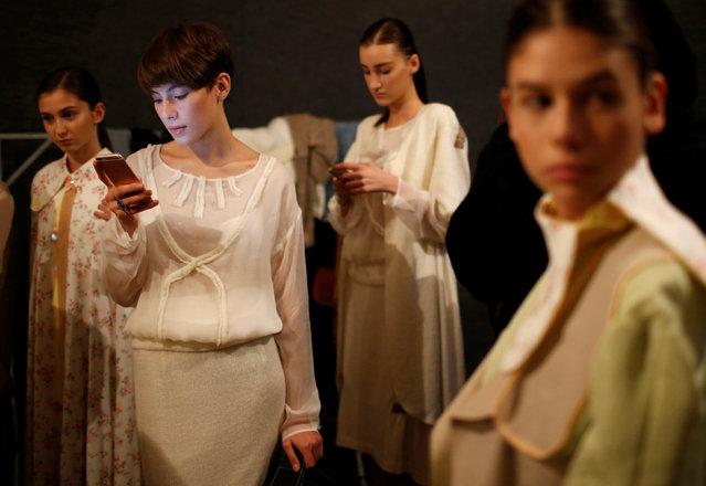 Models wait backstage at the Tbilisi Fashion Week in Tbilisi, Georgia, October 21, 2016. (Photo by David Mdzinarishvili/Reuters)