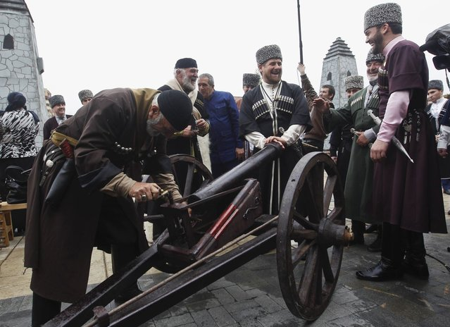 Chechen leader Ramzan Kadyrov (C) watches as men load up a cannon during a government-organised event marking Chechen language day in the centre of the Chechen capital Grozny April 25, 2013. (Photo by Maxim Shemetov/Reuters)