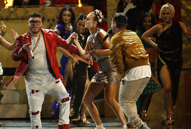 "Farruko (L), MO and J Balvin (R) perform ""Lean On"" during the Latin Recording Academy Person of the Year gala honoring Brazilian singer Roberto Carlos in Las Vegas, Nevada November 18, 2015. (Photo by Mario Anzuoni/Reuters)"