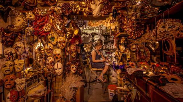 """""""The mask lady, Venice"""". According to Venetian-born mask maker Marilisa Dal Cason, each of her creations has its own personality, which can help the user enter another world. Honourable mention: People and portraits. (Photo by Dean Saffron/SIPA Contest)"""