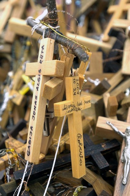 Some leave messages to God along with a cross. (Photo by Richard Gardner/Rex USA)