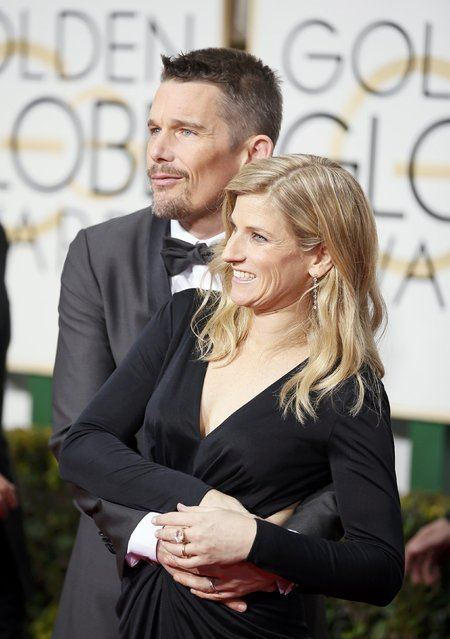 Actor Ethan Hawke and his wife, Ryan Hawke, arrive at the 72nd Golden Globe Awards in Beverly Hills, California January 11, 2015. (Photo by Danny Moloshok/Reuters)