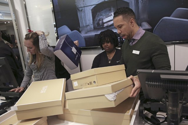 Staff members arrange shoe boxes at Macy's Herald Square store during the early opening of the Black Friday sales in the Manhattan borough of New York, November 26, 2015. (Photo by Andrew Kelly/Reuters)