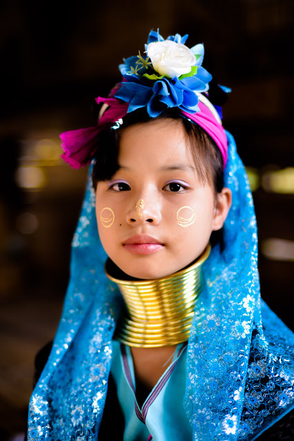 """""""Girl of the Long neck tribe, Baan Tong Luang"""". Picture taken at the Hill Tribe cultural preservation village in Northern Thailand, which apparently was created to preserve the old traditional ways of Hill Tribe agriculture and thereby providing an income for the Hill Tribe people from the tourist revenues. Location: Chiang Mai, Northern Thailand. (Photo and caption by Vijay Aitha/National Geographic Traveler Photo Contest)"""