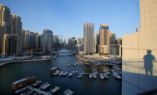 In this April 1, 2015 photo, Yachts are moored at the southern end of the Marina waterfront in Dubai, United Arab Emirates. High-rise buildings, stacked row after row, make up this 50 million sq. foot (4.65 million sq .meter) waterfront neighborhood that is built around a man-made canal. Owning an apartment in one of these towers means access to skyline pools, concierge services and grand apartments that cater to the region's royalty, as well as the world's wealthiest businessmen and women. (Photo by Kamran Jebreili/AP Photo)