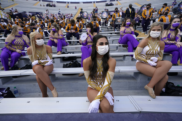 Members of the LSU Golden Girls dance team sit spaced apart wearing masks, under COVID-19 restrictions, requiring social distancing and masks, before an NCAA college football game between the LSU and the Mississippi State in Baton Rouge, La., Saturday, September 26, 2020. (Photo by Gerald Herbert/AP Photo)