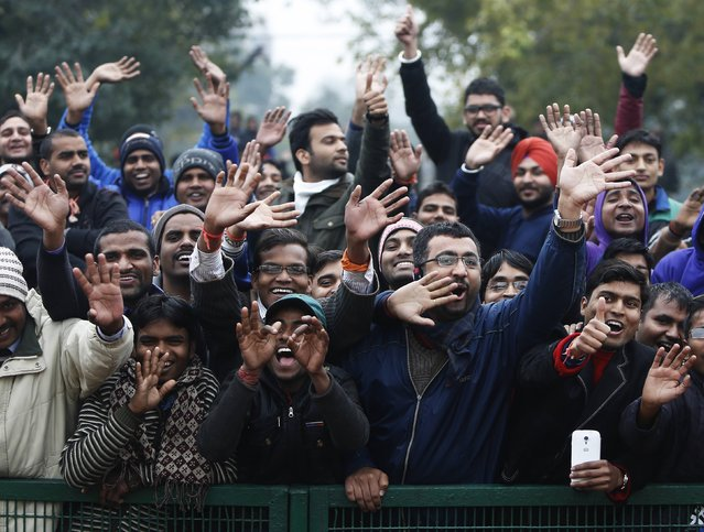 Spectators cheer as a cavalcade carrying U.S. President Barack Obama (not pictured) drives past as he leaves after attending the 66th Republic Day parade in New Delhi January 26, 2015. (Photo by Anindito Mukherjee/Reuters)