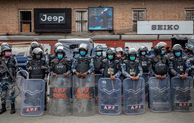 Rriot police stand guard during a pro-government rally in support of Prime Minister KP Sharma Oli in Kathmandu, Nepal, 05 February 2021. (Photo by Narendra Shrestha/EPA/EFE)