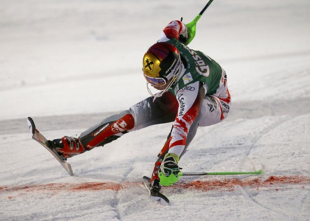Marcel Hirscher of Austria slides into the finish area after his slalom run in the men's Alpine Skiing World Cup super combined race in Kitzbuehel January 23, 2015. (Photo by Leonhard Foeger/Reuters)