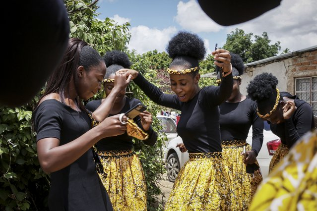 Bridesmaids dance while attending a traditional marriage ceremony of a friend in the capital Harare, Zimbabwe Saturday, March 6, 2021. (Photo by Tsvangirayi Mukwazhi/AP Photo)