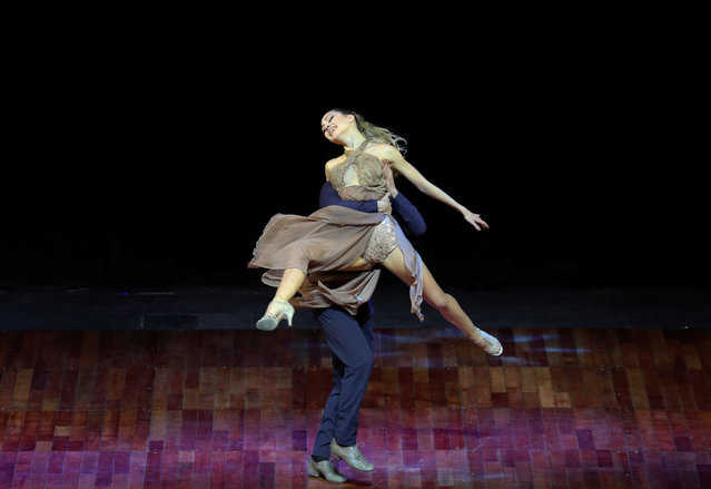 Leonardo Atuel Pankow and Cecilia Vicencio, representing the city of Moron, Argentina, dance during the Stage style final round at the Tango World Championship in Buenos Aires, Argentina on August 23, 2018. (Photo by Marcos Brindicci/Reuters)