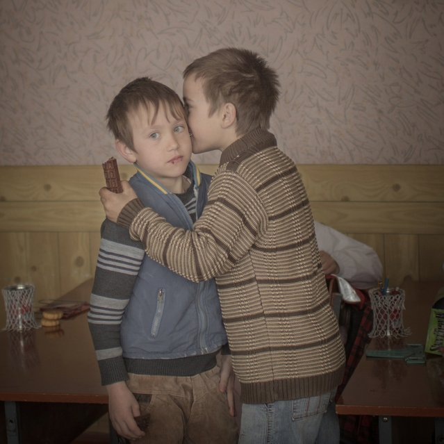 Asa Sjostrom, a Swedish photographer working for Moment Agency, won the Second Prize in the Daily Life Category, Singles, of the 2015 World Press Photo contest with this image of twin brothers Igor and Arthur handing out chocolates to their classmates to celebrate their ninth birthday in Baroncea, Moldova, in this picture taken March 24, 2014 and released by the World Press Photo on February 12, 2015. (Photo by Asa Sjostrom/Reuters/Moment/Institute for Socionomen/UNICEF/World Press Photo)
