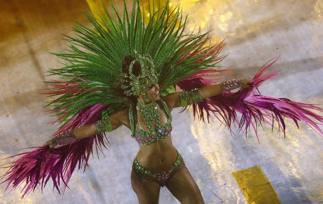 A reveller from the Mangueira samba school participates in the annual carnival parade in Rio de Janeiro's Sambadrome, February 15, 2015. (Photo by Ricardo Moraes/Reuters)