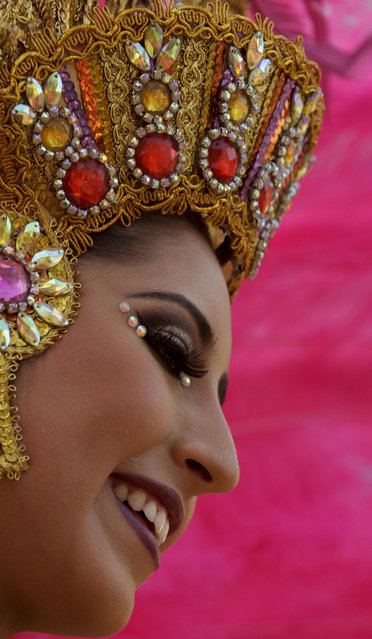 A Carnival queen smiles during Carnival celebrations in Panama City, Monday, February 16, 2015. (Photo by Arnulfo Franco/AP Photo)