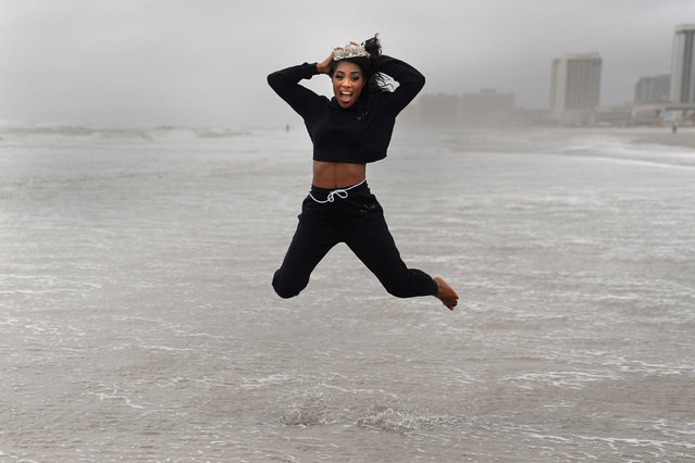 Miss America Nia Imani Franklin jumps as she poses for photos at the beach after she won Miss America, in Atlantic City, New Jersey, U.S., September 10, 2018. (Photo by Carlo Allegri/Reuters)