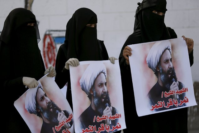 "Supporters of the Houthi movement protest against the execution of Shi'ite Muslim cleric Nimr al-Nimr in Saudi Arabia, during a demonstration outside the Saudi embassy in Sanaa, Yemen January 7, 2016. The posters read: ""Martyr Sheikh Nimr al-Nimr"". (Photo by Khaled Abdullah/Reuters)"