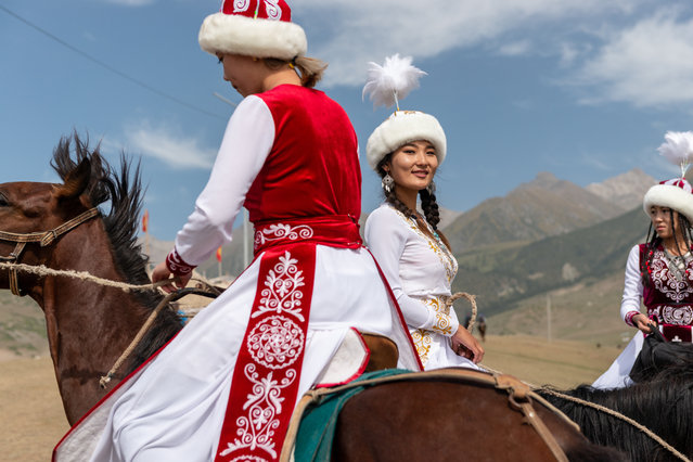 """A group of Kyrgyz female stunt riders take some time out from the games to ride together and talk. Their performance consists of men chasing them for a kiss, as if the men are """"bride-kidnapping"""". But the tradition is mocked when the women return the chase, catching up to the kiss thief and whipping him. This was performed numerous times during the World Nomad Games and would bring the audience to roaring laughter. (Photo by Eleanor Moseman/The Guardian)"""