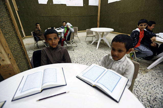 Saudi brothers of al-Fefi family attend a Koran class after making their way to their school through Fifa Mountain, in Jazan, south of Saudi Arabia, December 15, 2016. (Photo by Mohamed Al Hwaity/Reuters)