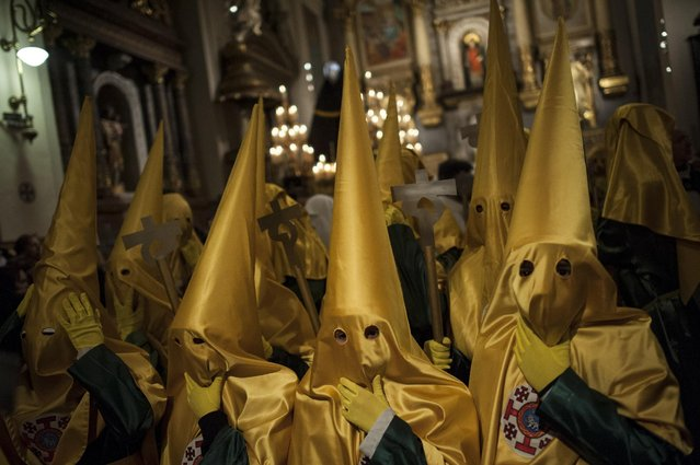 "Masked penitents take part in the procession of the ""La Dolorosa"" brotherhood, in Pamplona northern Spain, Friday, March 20, 2015, a large week prior to celebrate Holy Week. (Photo by Alvaro Barrientos/AP Photo)"