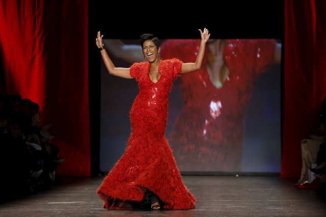 Tamron Hall presents a creation during the American Heart Association's (AHA) Go Red For Women Red Dress Collection, presented by Macy's at New York Fashion Week February 11, 2016. (Photo by Andrew Kelly/Reuters)