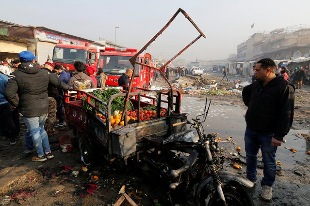 People gather at the site of a car bomb attack at a vegetable market in eastern Baghdad, Iraq January 8, 2017. (Photo by Wissm al-Okili/Reuters)