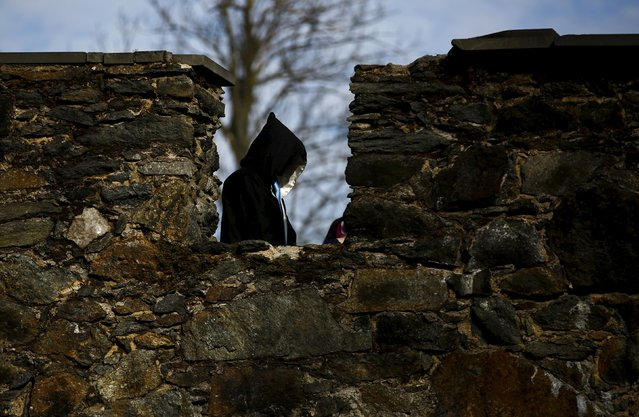 A participant walks near a castle defense wall before the role play event at Czocha Castle in Sucha, west southern Poland April 9, 2015. (Photo by Kacper Pempel/Reuters)