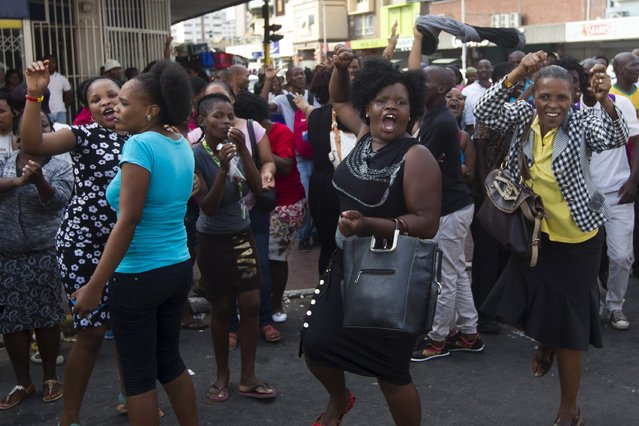 South African women protest as rioting and looting is quelled during anti-foreigner violence in Durban, April 14, 2015. The wave of anti-foreigner violence that has killed four people in and around the South African city of Durban in recent days, spread to the town center on Tuesday, local media reported, with police firing rubber bullets to disperse angry crowds. (Photo by Rogan Ward/Reuters)
