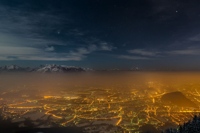 In this view of Salzburg, Austria, a blanket of cold fog filters out light from the city, allowing the stars above the surrounding mountain range to sparkle. And despite the glow of a near full moon, the wintertime constellations of Orion and Taurus, as well as the planet Jupiter, burn brightly. The photo, taken by Andreas Max Böckle, was a winner in the Fourth International Earth and Sky Photo Contest. It was published – along with a gallery of other winning shots – by National Geographic Daily News in May. (Photo by Andreas Max Böckle/National Geographic)