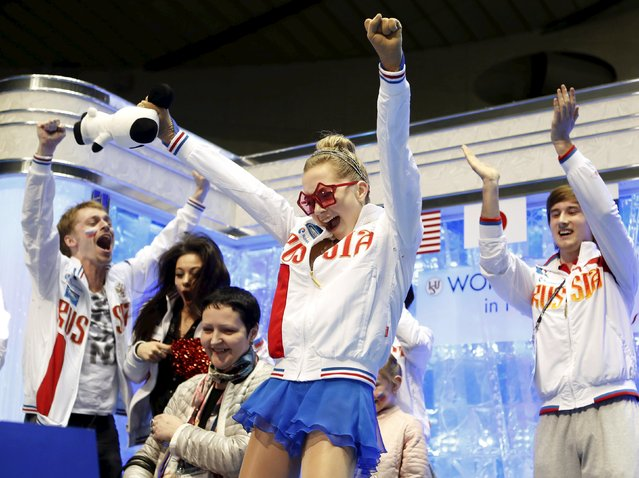 "Elena Radionova of Russia reacts with her teammates at the ""kiss and cry"" at the ISU World Team Trophy in Figure Skating in Tokyo April 18, 2015. (Photo by Yuya Shino/Reuters)"