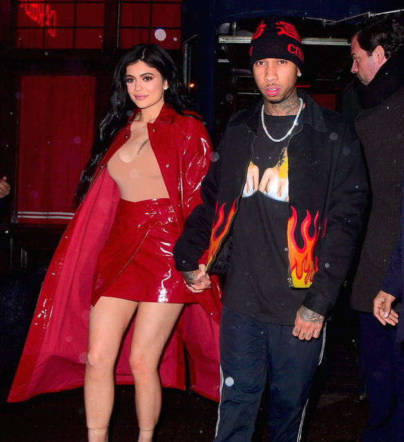 Kylie Jenner was spotted holding hands with Boyfriend, Tyga, as the couple left Carbone Italian Restaurant in NYC on January 18, 2017. The couple enjoyed a 3 hour romantic date night on Tuesday night in the Greenwich Village restaurant. Kylie looked smoking hot with a Red PVC Skirt and Duster Jacket, with a tight busty skin tone top. Tyga led the way, wearing a Flame jacket, track pants and Revenge x Storm Sneakers. (Photo by Splash News and Pictures)