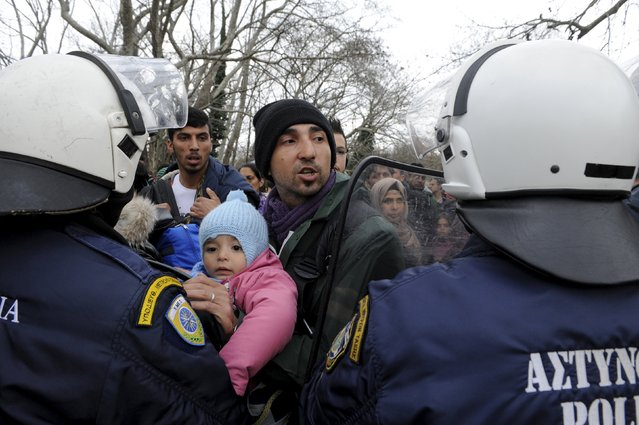 Migrants are stopped by Greek riot police as they look for a way to cross the Greek-Macedonian border, near the village of Idomeni, Greece, March 14, 2016. (Photo by Alexandros Avramidis/Reuters)