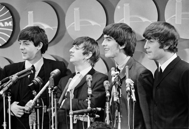 The Beatles meet reporters at Kennedy Airport in New York City, February 7, 1964 on their arrival from London for their first American tour. The band members, from left, are, Paul McCartney, Ringo Starr, George Harrison, and John Lennon. (Photo by AP Photo)