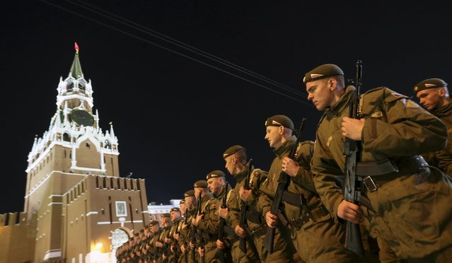 Russian servicemen march during a rehearsal for the Victory parade, with the Kremlin's Spasskaya (Saviour) Tower seen in the background, on Moscow's Red Square May 4, 2015. (Photo by Sergei Karpukhin/Reuters)