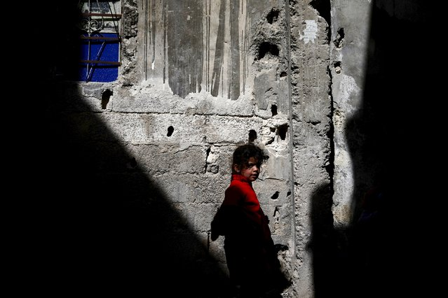 A girl walks along a street in the rebel-held Tishreen neighborhood of Damascus, Syria March 14, 2016. (Photo by Bassam Khabieh/Reuters)