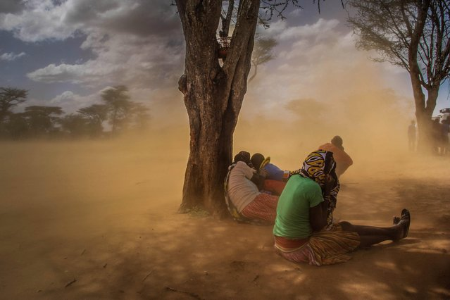 People look for cover when these dusty gushes of wind happen, Karamoja, Uganda, February, 2017. (Photo by Sumy Sadurni/Barcroft Images)