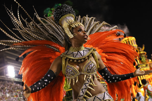 Elaborately costumed members of a dance troupe from the Grande Rio samba school pictured as they take part in the Brazil Carnival. (Photo by Moisés Schini/Demotix)