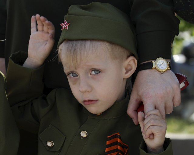 A boy dressed in a historical military uniform attends the so-called parade of children's troops in Rostov-on-Don, southern Russia, May 14, 2015. (Photo by Eduard Korniyenko/Reuters)