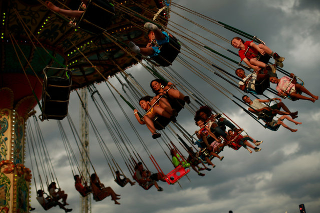 People enjoy a ride at an amusement park during Memorial Day weekend on May 26, 2019 in Seaside Heights, New Jersey. Memorial Day is the unofficial start of summer and this year New Jersey has banned smoking and vaping on nearly every public beach under tougher new restrictions. (Photo by Kena Betancur/Getty Images)