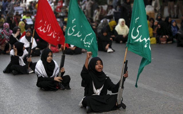 Pakistani Shi'ite supporters of Imamia Students Organisation (ISO) hold signs and chant slogans during anti-Israel and anti-U.S. rally to condemn the day marking the anniversary of the recognition and formation of Israel and the U.S. support for it, in Karachi, Pakistan, May 16, 2015. (Photo by Akhtar Soomro/Reuters)