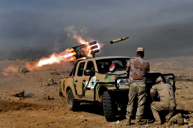 Members of the Iraqi army's 9th Division fire a multiple rocket launcher from a hill in Talul al-Atshana, on the southwestern outskirts of Mosul, on February 27, 2017, during an offensive to retake the city from Islamic State (IS) group fighters. (Photo by Aris Messinis/AFP Photo)