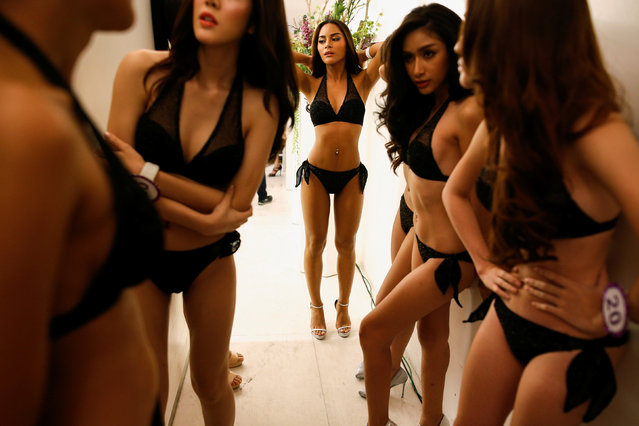 Beauty contestants prepare backstage before the fashion show of Miss Tiffany's Universe 2016 transvestite contest in Bangkok, Thailand, April 20, 2016. (Photo by Athit Perawongmetha/Reuters)