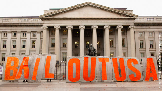Occupy Washington D.C. demonstrators stop outside the Treasury Department while marching to the Federal Housing Finance Agency (FHFA)