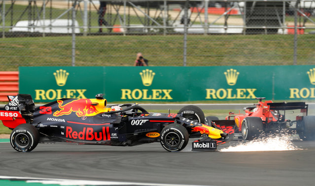 Max Verstappen of the Netherlands driving the (33) Aston Martin Red Bull Racing RB15 and Sebastian Vettel of Germany driving the (5) Scuderia Ferrari SF90 crash during the F1 Grand Prix of Great Britain at Silverstone on July 14, 2019 in Northampton, England. (Photo by John Sibley/Reuters)