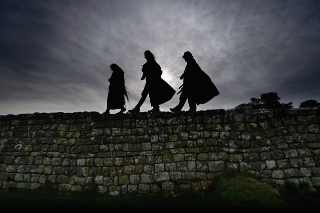 Members of the public visit Hadrian's Wall at Housesteads Roman Fort, the wall was started in AD 122 on the orders of Emperor Hadrian to keep out the Picts from Scotland on April 17, 2014 in England. A referendum on whether Scotland should be an independent country will take place on September 18, 2014. (Photo by Jeff J Mitchell/Getty Images)