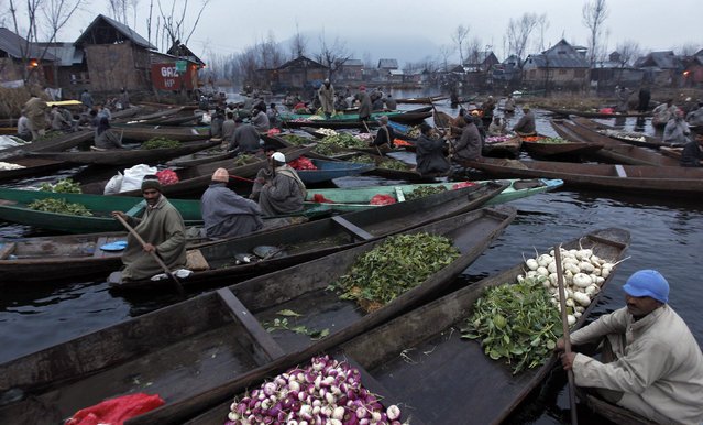 Kashmiri vegetable vendors assemble at a floating market in the interiors of the Dal Lake in Srinagar January 14, 2011. (Photo by Danish Ismail/Reuters)