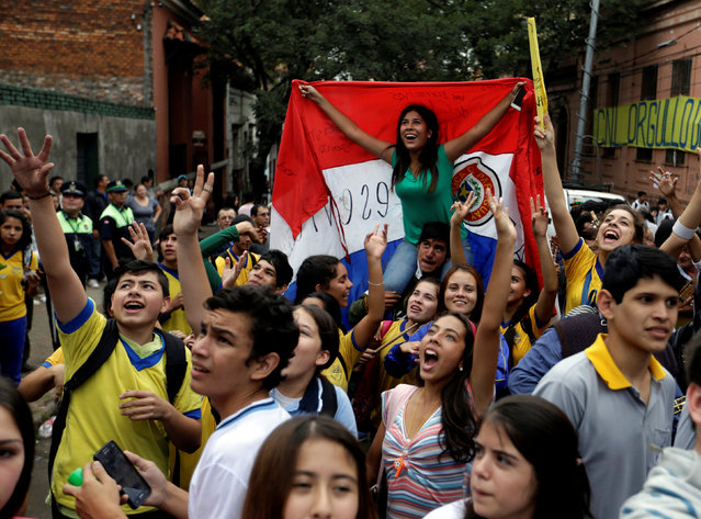 Students on the street in front of Republica Argentina school celebrate after Paraguay's Education Minister Marta Lafuentein resigned in Asuncion, Paraguay, May 5, 2016. (Photo by Jorge Adorno/Reuters)