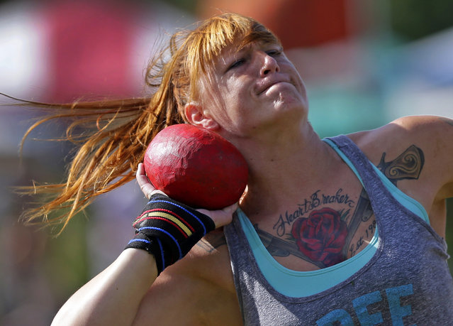 Amanda Ford, of Wilmington, N.C., prepares to throw the 8 pound stone during the 59th annual Grandfather Mountain Highland Games in Linville, N.C., Friday, July 10, 2015. This is the first year women have been allowed to compete in the games. (Photo by Chuck Burton/AP Photo)